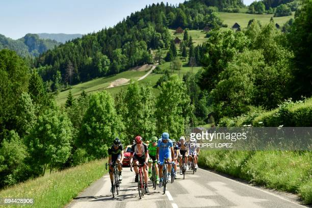 Cyclists ride in a breakaway during the 168 km seventh stage of the 69th edition of the Criterium du Dauphine cycling race on June 10 2017 between...