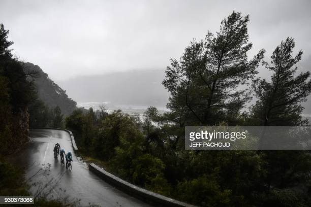 Cyclists ride in a breakaway during the eighth stage of the Paris Nice cycling race in and around Nice on March 11 2018 PACHOUD