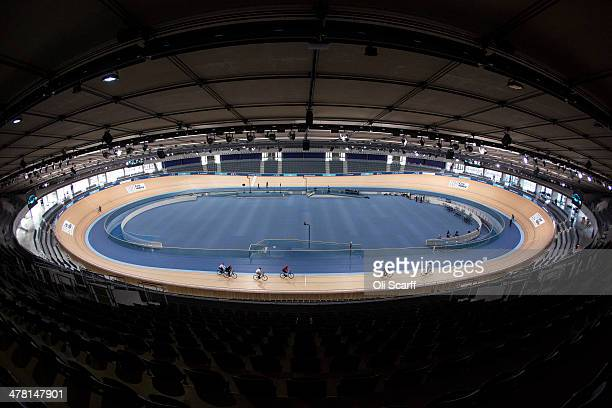 Cyclists ride in the Velodrome at the Lee Valley Velopark, formerly the cycling venue for the London 2012 Olympic Games, on March 12, 2014 in London,...