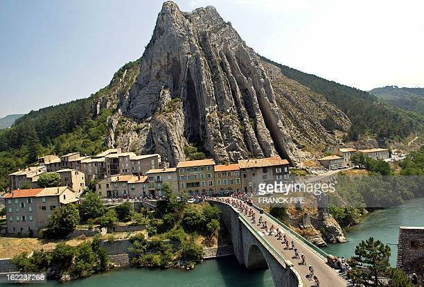 cyclists ride on a bridge in Sisteron during the 10th stage of the 90th Tour de France cycling race between Gap and Marseille 15 July 2003 AFP PHOTO...