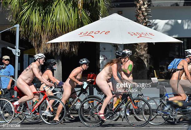 Cyclists ride past restaurants in St Kilda as they take part in the World Naked Bike Ride in Melbourne on February 28 2016 The World Naked Bike Ride...