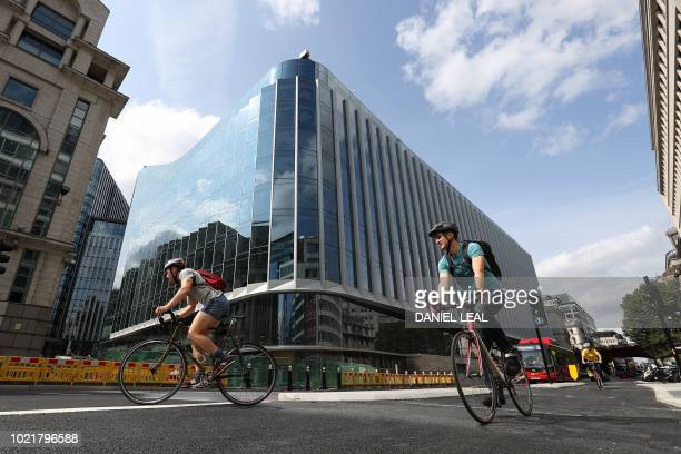 Cyclists ride past the new European headquarters of Goldman Sachs in the finacial district of London on August 23 2018 Goldman Sachs has sold his new...