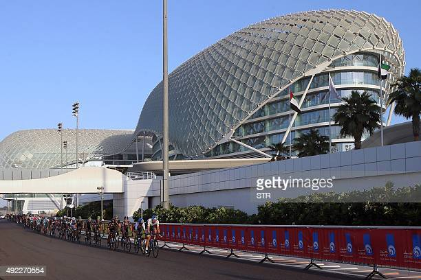 Cyclists ride their bikes during the Abu Dhabi tour from the Yas Marina Circuit to Yas Mall where the tour finishes in the Emirati capital Abu Dhabi...