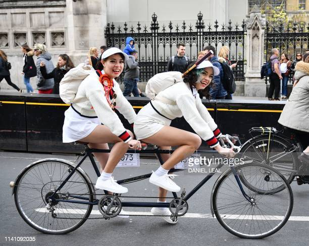 Cyclists ride their tandem bicycle on The Tweed Run cycle ride through central London on May 4 2019 Hailed as 'the metropolitan bicycle ride with a...