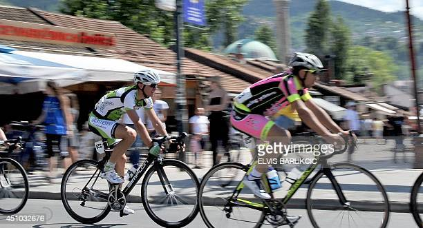 Cyclists ride through Sarajevo during the Sarajevo Grand Prix on Sunday June 22 2014 Thousands of cyclists including three former Tour de France...