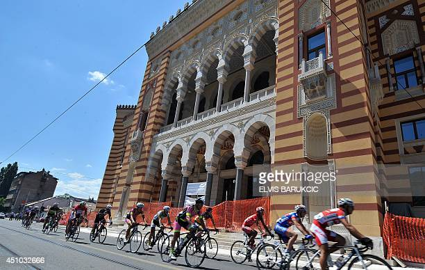 Cyclists ride through Sarajevo during the Sarajevo Grand Prix on June 22 2014 Thousands of cyclists including three former Tour de France Champions...
