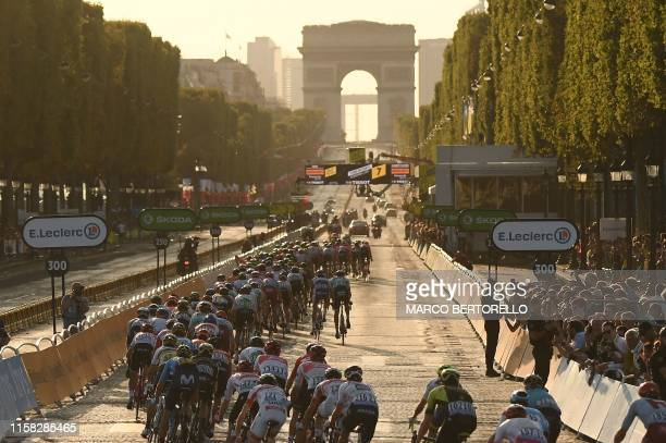 Cyclists ride up the Champs Elysees with Arc de Triomphe in background during the 21st and last stage of the 106th edition of the Tour de France...