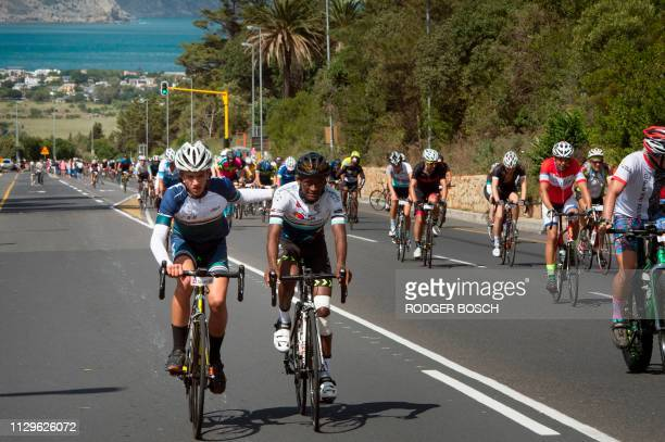 Cyclists ride up the final climb Suikerbossie near Hout Bay during the Cape Town Cycle Tour on March 10 in Cape Town This cycle tour is the largest...