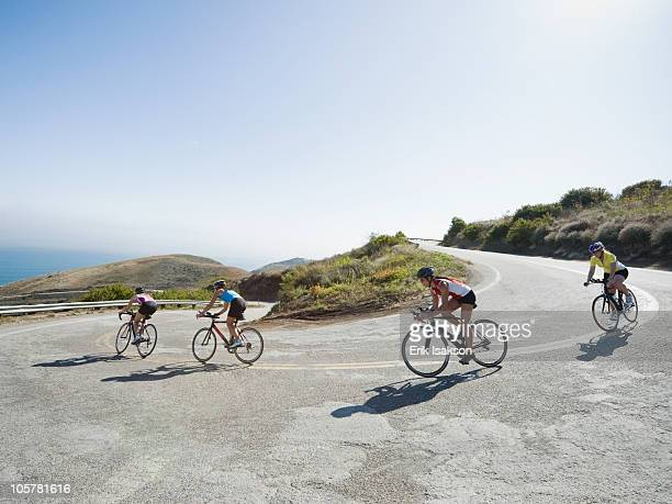 cyclists road riding in malibu - wielrennen stockfoto's en -beelden