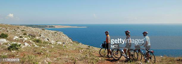 Cyclists soak up the view of the Mediterranean south of Otranto the last major town on the heel of Italy's boot