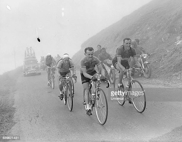 Cyclists Stan Ockers Jean Robic and Fausto Coppi on the 18th stage of the 1952 Tour de France | Location Between BagneresdeBigorre and Pau France