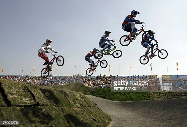 """Cyclists take a jump during the semi-final of the men's BMX Supercross Worldcup, part of the The """"Good Luck Beijing"""" series of Olympic test events..."""