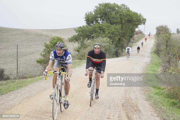 Cyclists take part at the Eroica on October 1 2017 in Gaiole in Chianti Siena Italy LEroica started in 1997 as a foundation for the protection and...