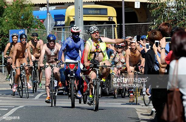 Cyclists take part in a Naked Bike Ride around the streets to expose the vulnerability of cyclists humanity and nature in the face of cars aggression...