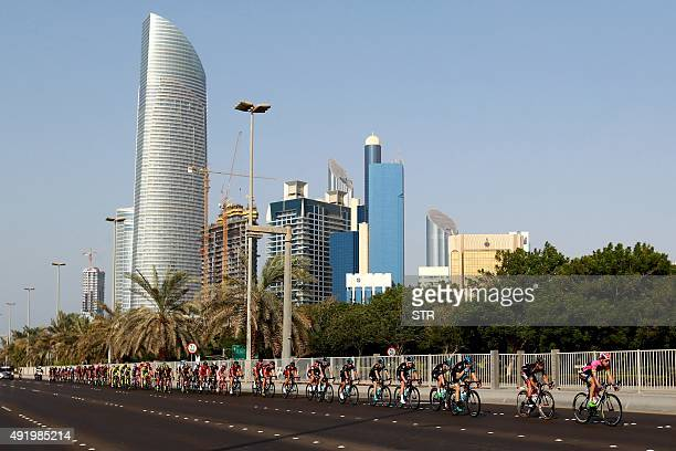 Cyclists take part in the second stage of the Abu Dhabi tour from Yas Marina Circuit to Yas Mall where the tour finishes in the Emirati capital Abu...