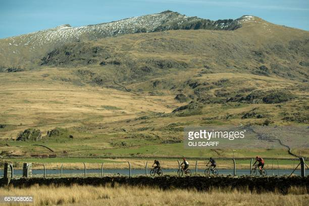 Cyclists take part in the 'Snowdonia Mountain Bike Challenge' near Llanberis north Wales on March 26 2017 The Challenge is the only mountain bike...