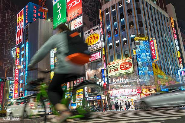 Cyclists & traffic at crossing at night, Shinjuku