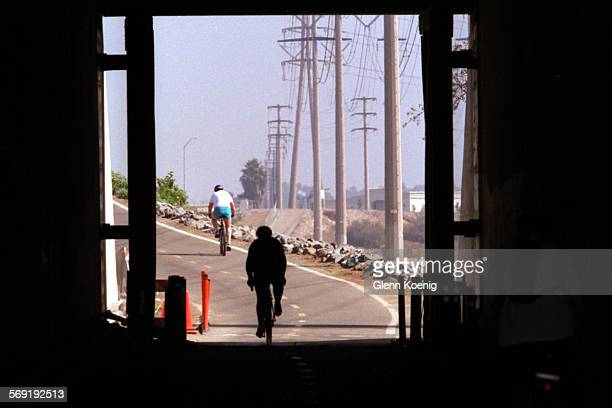 Cyclists travel northbound under the San Diego Freeway on the Santa Ana River Bike Trail in Costa Mesa Photo was taken about 1000am on a Sunday...