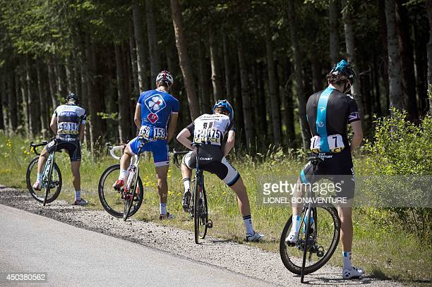 Cyclists urinate during the third stage of the 66th edition of the Dauphine Criterium cycling race on June 10 2014 in Le Teil southern France AFP...
