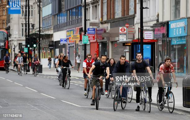 Cyclists wait for a traffic light to change on Oxford Street in central London on June 3 as life in Britain continues during the nationwide lockdown...