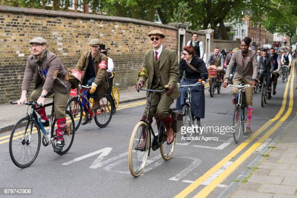 Cyclists wearing vintage clothing and attire take part in the annual Tweed Run riding around the streets and sights in London United Kigdom on May 06...