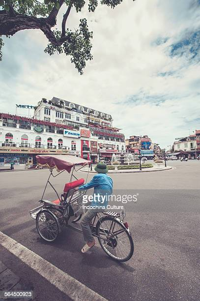 Cyclo driver in old town Hanoi, Vietnam