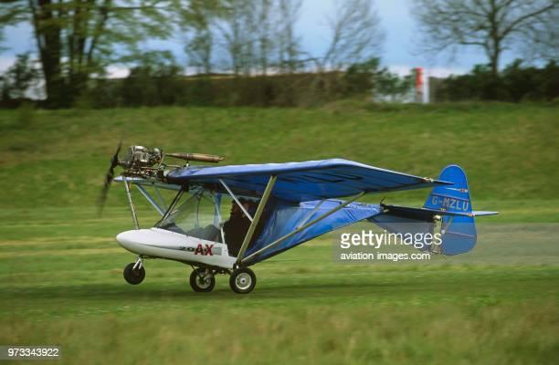 Cyclone AX3503 microlight takingoff from grass