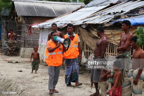 Cyclone Preparedness Programme volunteer uses a megaphone to urge residents to evacuate to shelters ahead of the expected landfall of cyclone Amphan...