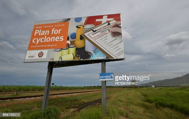 A cyclone warning sign is seen outside the city of Townsville in far north Queensland on March 27 2017 Thousands of people including tourists were...