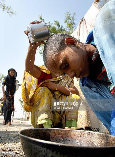A cycloneaffected mother treats her sick daughter Jasmin at Nishanbari village in the cyclone Sidr devastated Barguan district on the southern...