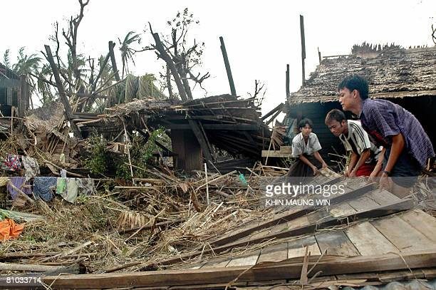 Cycloneaffected residents reconstruct their destroyed house in Kungyangon in the outskirts of Yangon on May 8 2008 The UN is to launch an urgent...