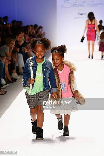 Cyia and Jaeden Sabathia walk the runway at Strut The Fashionable Mom Show during MercedesBenz Fashion Week Spring 2014 at Lincoln Center for the...