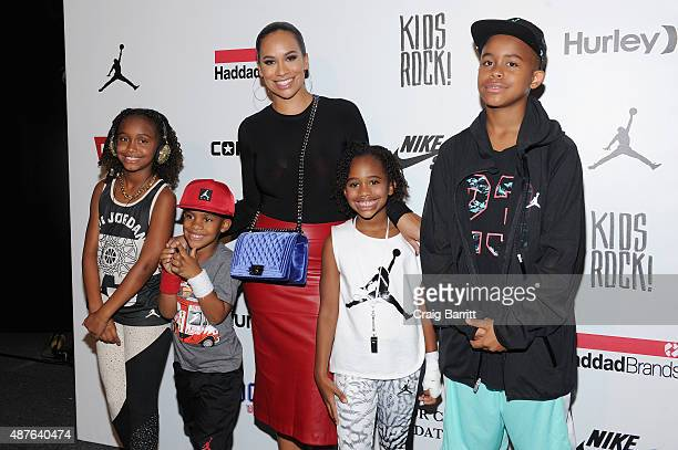 Cyia Sabathia Carter Sabathia Amber Sabathia Jaden Sabathia and CC III Sabathia pose backstage at the Kids Rock fashion show during Spring 2016 New...