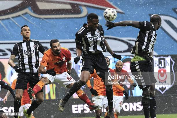 Cyle Christopher Larin of Besiktas in action against Arda Turan of Galatasaray during the Turkish Super Lig week 19 soccer match between Besiktas and...