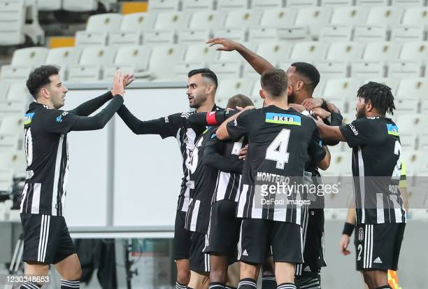 Cyle Larin of Besiktas JK celebrates after scoring his team's second goal with teammates during the Sueper Lig match between Besiktas Istanbul and...