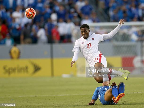 Cyle Larin of Canada goes down as he is fouled by Alexander Mendoza of El Salvador in their CONCACAF Gold Cup Group B match at StubHub Center on July...