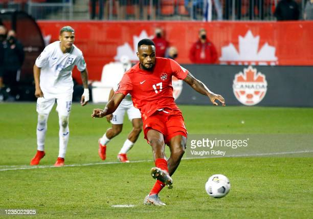 Cyle Larin of Canada scores a penalty during a 2022 World Cup Qualifying match against Honduras at BMO Field on September 2, 2021 in Toronto,...