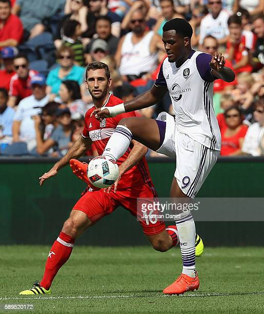 Cyle Larin of Orlando City FC controls the ball in front of Jonathan Campbell of Chicago Fire during an MLS match at Toyota Park on August 14 2016 in...