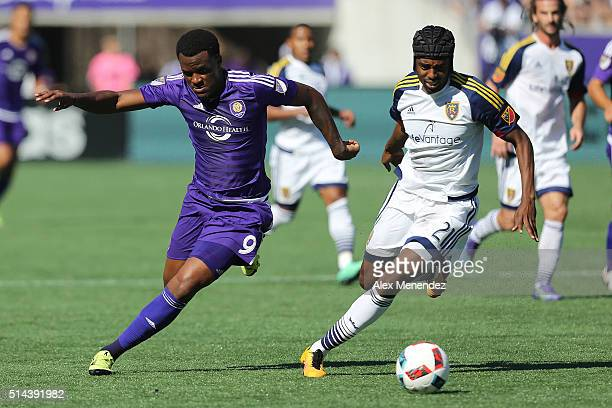 Cyle Larin of Orlando City SC and Aaron Maund of Real Salt Lake chase a loos ball during a MLS soccer match at the Orlando Citrus Bowl on March 6...
