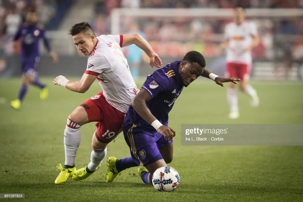 Cyle Larin #9 of Orlando City SC and Alex Muyl #19 of New York Red Bulls fall down trying to get control of the ball during the MLS match between New York Red Bulls and Orlando City SC at the Red Bull Arena on August 12, 2017 in Harrison, NJ. The New York Red Bulls won the match with a score of 3 to 1.