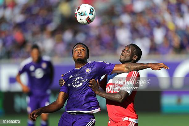 Cyle Larin of Orlando City SC and JeVaughn Watson of New England Revolution fight for the ball during a MLS soccer match at the Orlando Citrus Bowl...