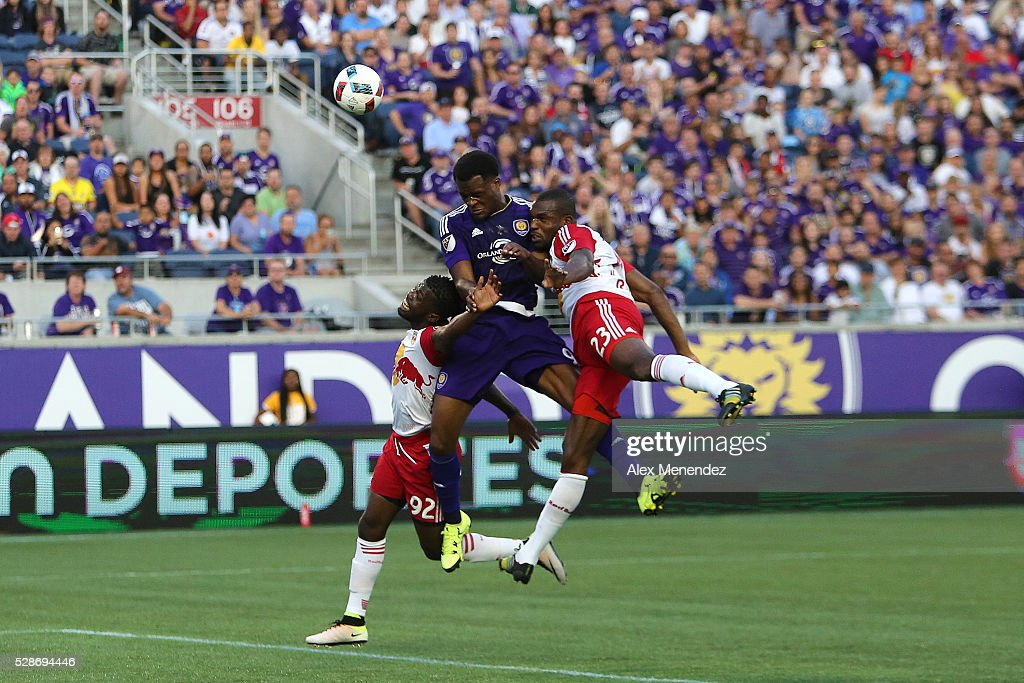 Cyle Larin #9 of Orlando City SC fights for the ball between Kemar Lawrence #92 and Ronald Zubar #23 of New York Red Bulls during an MLS soccer match at Camping World Stadium on May 6, 2016 in Orlando, Florida. The game ended in a 1-1 draw.