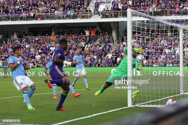 Cyle Larin of Orlando City SC scores a goal past goalkeeper Sean Johnson of New York City FC during a MLS soccer match between New York City FC and...