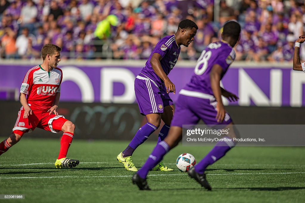 Cyle Larin #9 of the Orlando City Lions advances with the ball against the New England Revolution at the Citrus Bowl in Orlando, Florida on April 17, 2016.