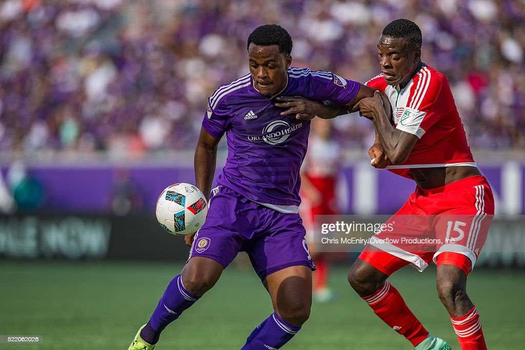 Cyle Larin #9 of the Orlando City Lions defends the ball from Je-Vaughn Watson #15 of the New England Revolution at the Citrus Bowl in Orlando, Florida on April 17, 2016.