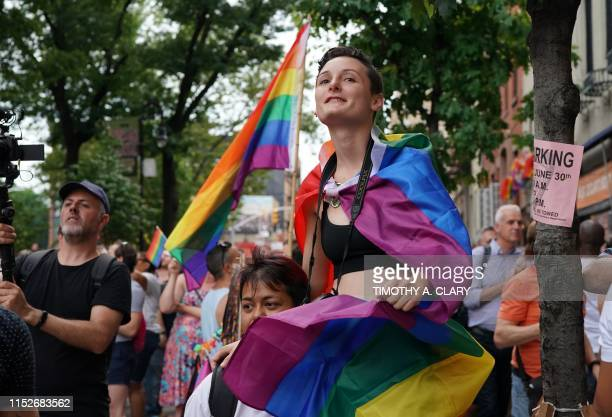 Cylina Case and Beatrice Nava from California join people as they mark the 50th anniversary of the Stonewall Riots near the Stonewall Inn in New...