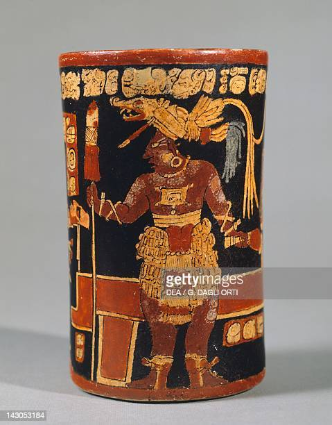 Cylindrical vase showing a depiction of a figure in a parade and hieroglyphic text artifact originating from Tikal Mayan Civilization Guatemala City...