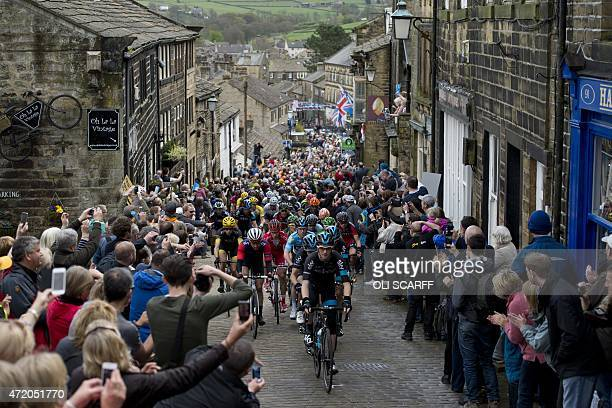 Cylists ride on a cobblestone street through the village of Haworth as they take part on the third and final day of the inaugural 'Tour de Yorkshire'...
