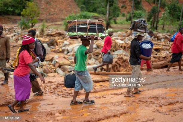 Cylone survivors leave the Ngangu township with their belongings to Chimanimani Hotel where hundreds are sheltered on March 18 2019 in Ngangu...