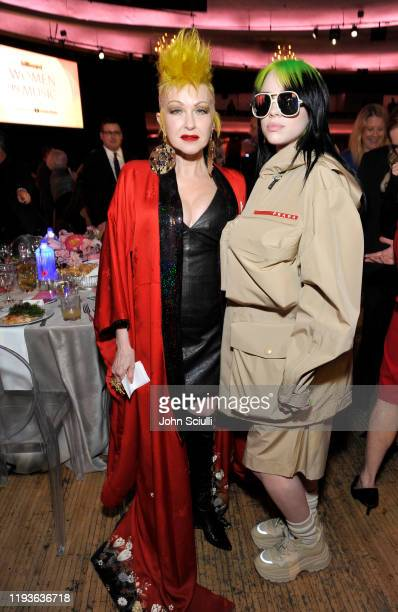 Cyndi Lauper and Billie Eilish are seen with FIJI Water and JNSQ at Billboard's Women In Music 2019 on December 12 2019 in Los Angeles California